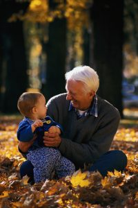 Elderly man playing with his grand child