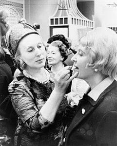 Estée Lauder putting makeup on client