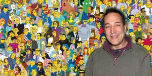 Sam Simon in front of The Simpsons background